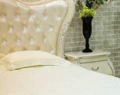 Upholstered headboard and bedding