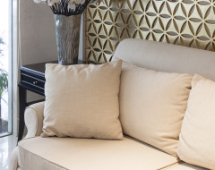 Upholstered couch and custom pillows